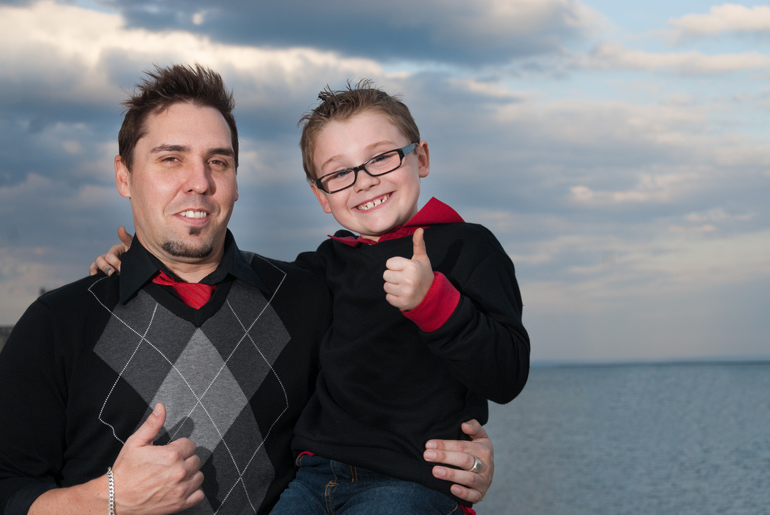 photo of father and son having fun on lake superior, marina Park in Thunder Bay