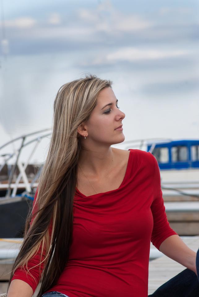 photo of a lady sitting on the deck of Lake superior, marina park, Thunder Bay