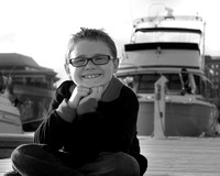 a boy in front of a boat, marina park, lake superior in Thunder Bay